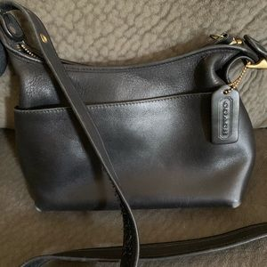 Black coach bag with front pocket and zipper inner